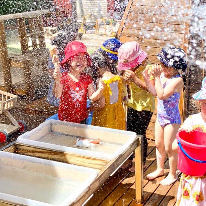 children splashing around wth water